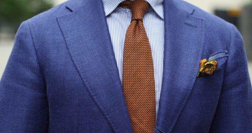Welke kleur stropdas bij een blauw pak- bruine stropdas blauw pak